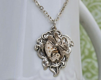 Steampunk necklace TIME TRAVELER antique silver steampunk watch movement necklace with calla lily flower and tiny dragonfly charm