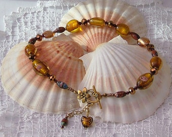 Gold coloured necklace with Murano and foiled lampwork beads lily toggle clasp
