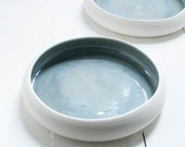 Two Rounded Porcelain Dishes in Smokey Blue and White Porcelain
