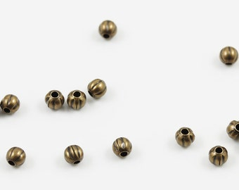 Antiqued gold plated 2.5mm corrugated round beads (100)