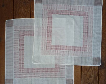 Two large cotton napkins with red ogee motif