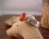 Textured silver and carnelian ring