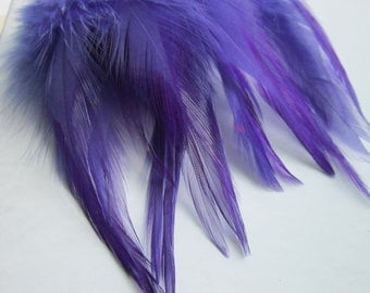 "Three inch strip REGAL Strung Rooster Saddles Feathers (individual feather about 3-3.5"")"