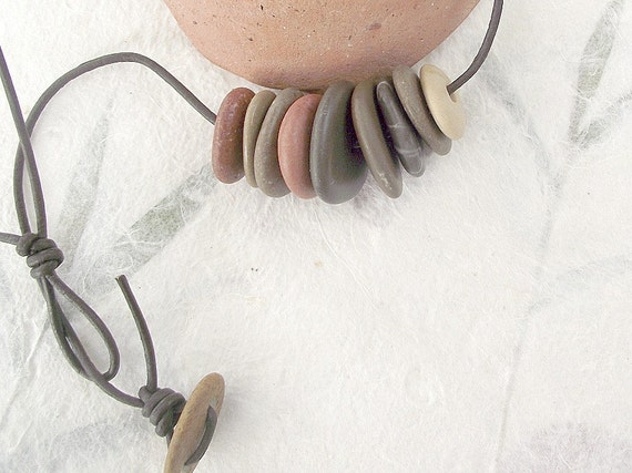 Natural beach rock pebble necklace with leather. Pebble button closure.