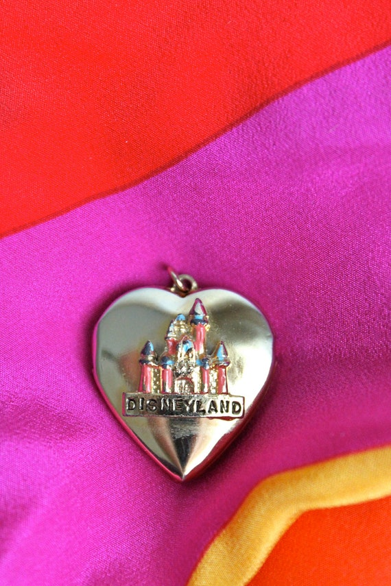 vintage Disneyland Cinderella's Castle gold tone locket // heart shaped