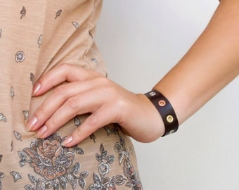 Brown leather cuff bracelet with silver gold copper eyelets