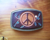 Belt Buckle with Leather insert. Stamped with Peace Symbol and Flowers