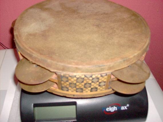 Tamborine with Egyptian shell and ebony inlaid design.