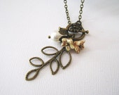 Autumn Leaf Necklace. antique brass leaf charm with pear pearl and flowers
