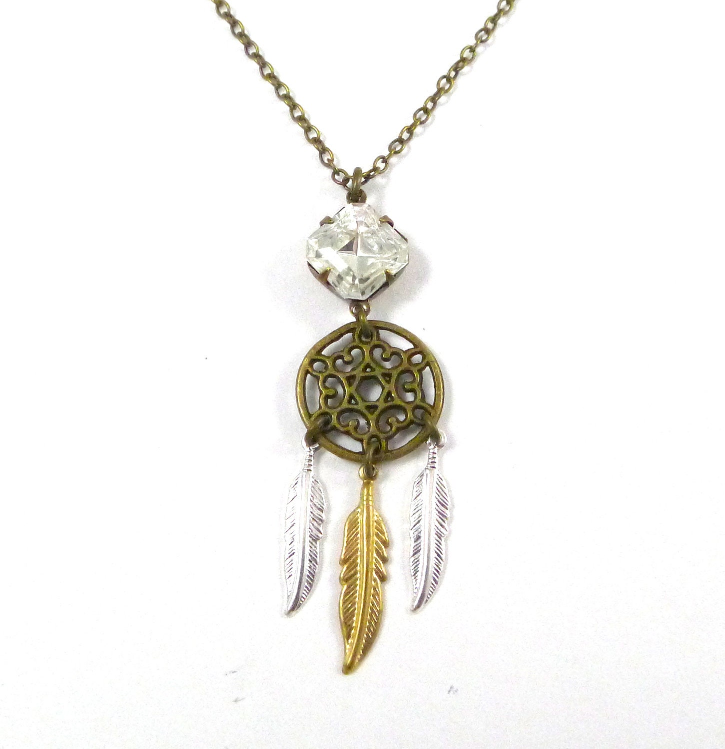 Dreamcatcher Adjustable Necklace Hung above beds to ensnare bad dreams, the dreamcatcher connects the universe with our minds. Traditionally handmade from a willow branch, they come to us from the Ojibwe Native American tribe. The web is imperfect, like a .