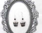 Black Decepticon symbol earrings