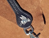 Sure, when Pigs Fly.  Well, Here it is - Flying Pig Black Leather Belt Key Fob with hand tooling