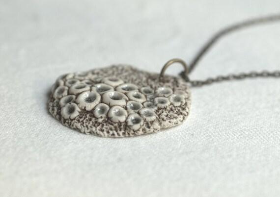 Rustic woodland porcelain pendant with fungi.
