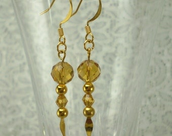 Gold Faceted Crystal Earrings on Gold Spear Pins
