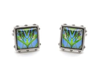 Hothouse scenery: eye catching cufflinks made with original photos mounted under glass