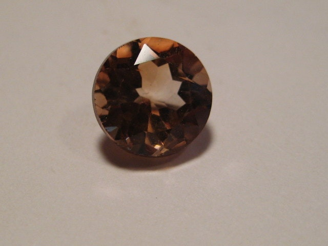 imperial topaz faceted gemstone 8 mm x 6mm