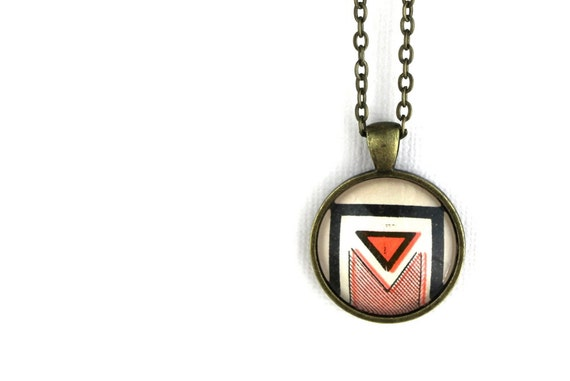 Neon pink geometric abstract shape pendant necklace made from vintage sheet music cover illustration