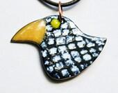 Small black and white enamel bird pendant