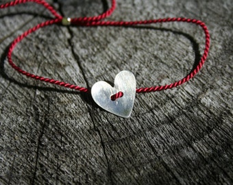 Red silk thread bracelet with brushed Sterling Silver heart - adjustable