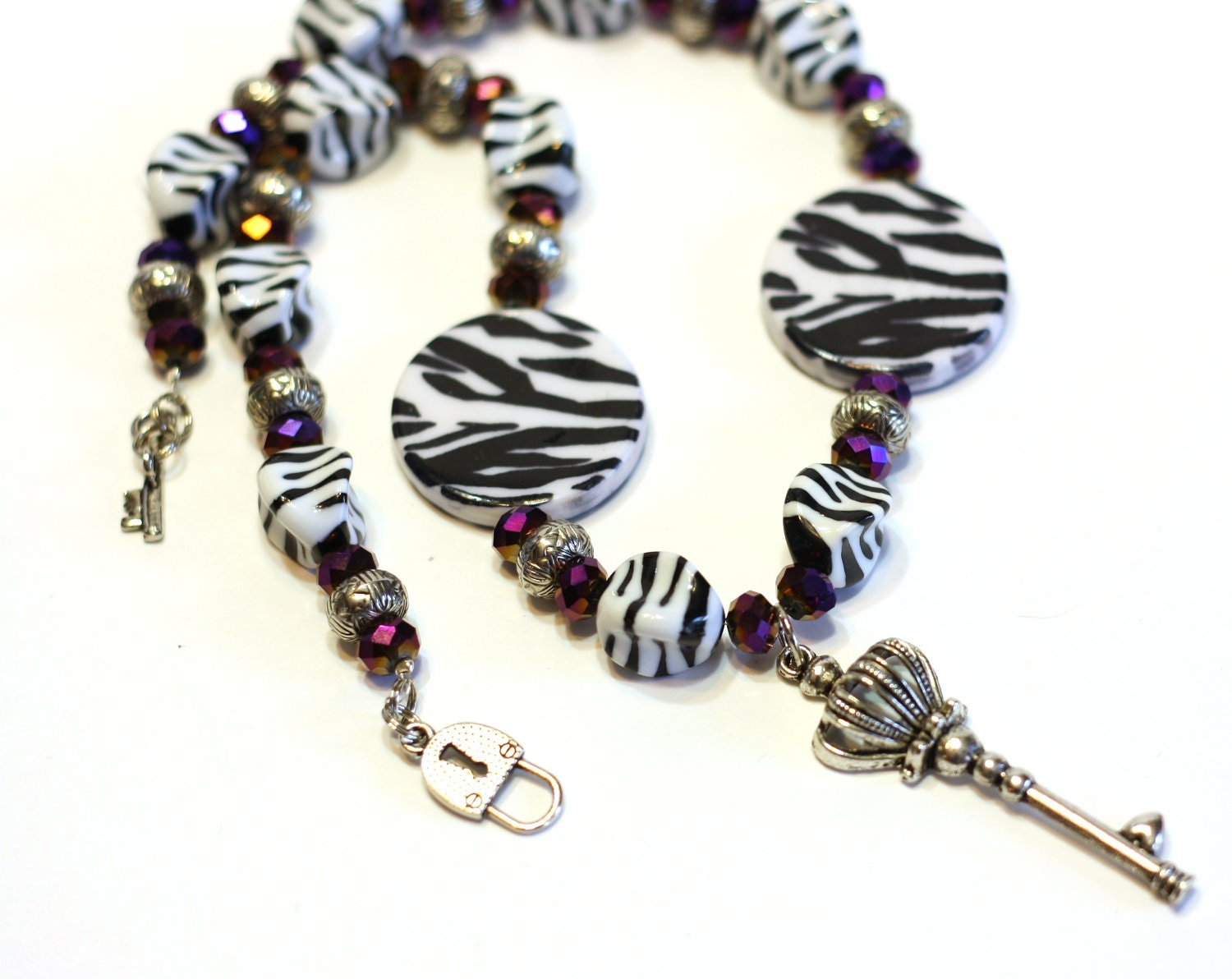 zebra beaded necklace in black and white stripes with purple