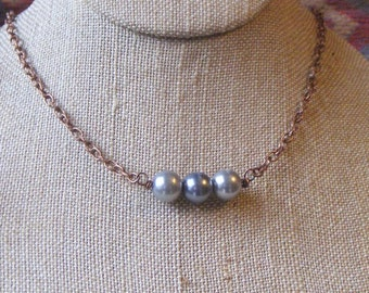 The Trinity Glass pearl and copper necklace
