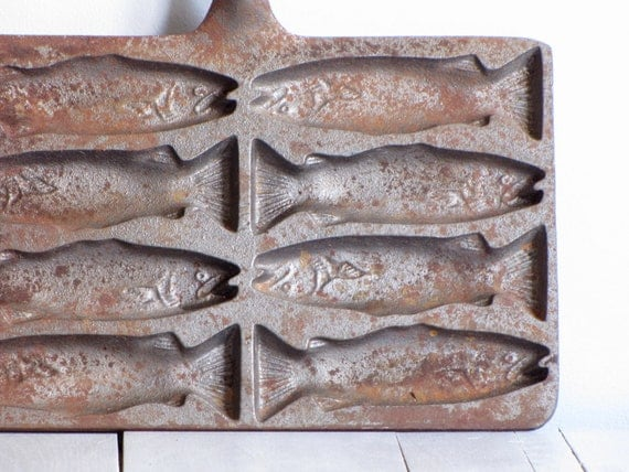 Antique cast iron fish molds for Cast iron fish