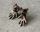 Surreal cat & dog earrings bronze
