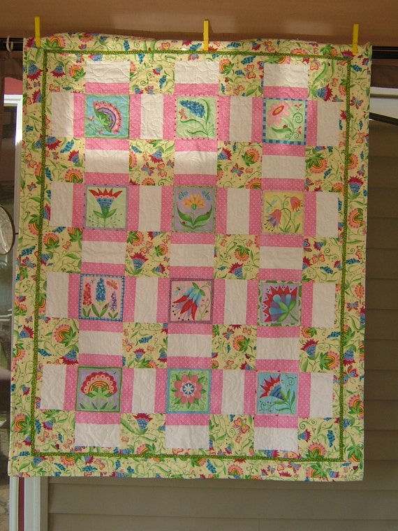 Crib size Quilt  featuring flowers and butterflies in yellow, pink, white with a pop of green