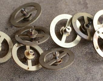 Vintage clock brass balance wheels -- set of 9 -- D1