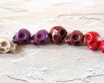 Pairs of Tiny Cream Colored, Purple, Brown, and Red Stone Skull Beads