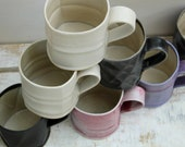 smooth textured coffee mugs in pink purple black and cream