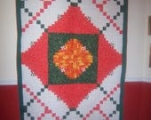 quilt  orange green off white  machine quilted  patchwork lyly leaves design