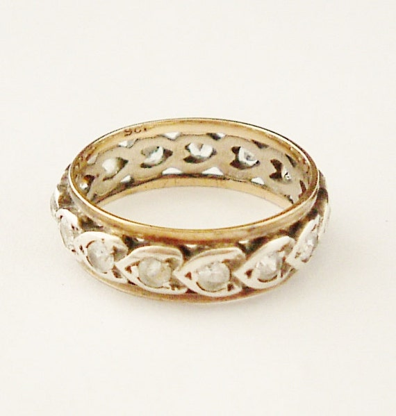 English 1950s sterling silver and 9k gold eternity ring