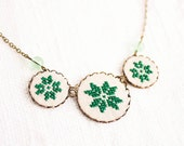 Geometrical green necklace with three cross stitch ethnic flower ornaments in bronze - gift for her - n009green