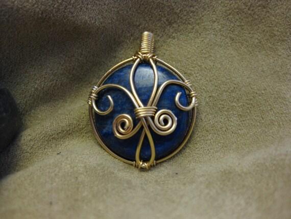 Fleur de Lis pendant with Lapis Lazuli