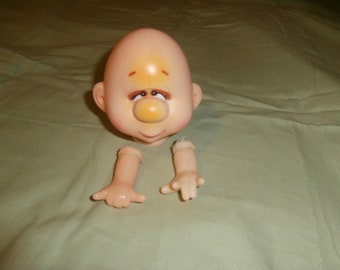 vintage hobo head with hands, doll head