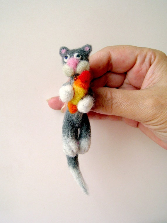 The cat with a fish - brooch