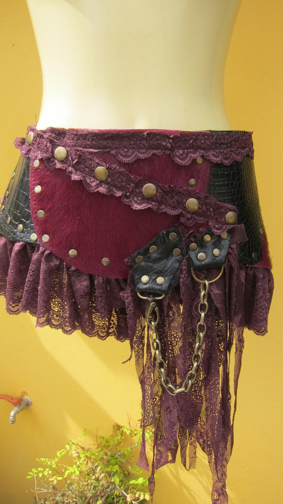 BURNING MAN..vintage inspired maroon fur/black patent leather skirt/belt with lace ruffles,studs and fringe detail...