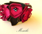 Leather cuff-bracelet-wristband in black and fuchsia