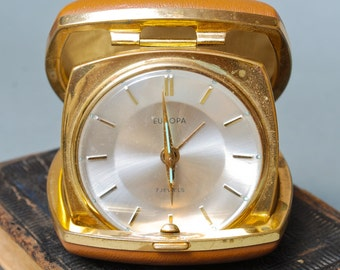 Vintage small mechanical alarm clock Europa in the leather box