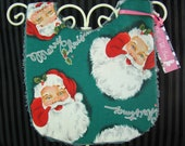 Baby bib with Santa Claus by Kiss and Tell Baby
