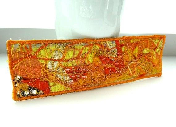 fabric bookmark orange  -- Mixed media material oranges, yellow and gold bookmark in fibre, black felt back