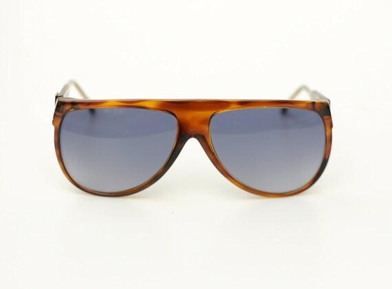 2f6e2c670e Anne Klein AK 7033 in Tortoise Sunglasses