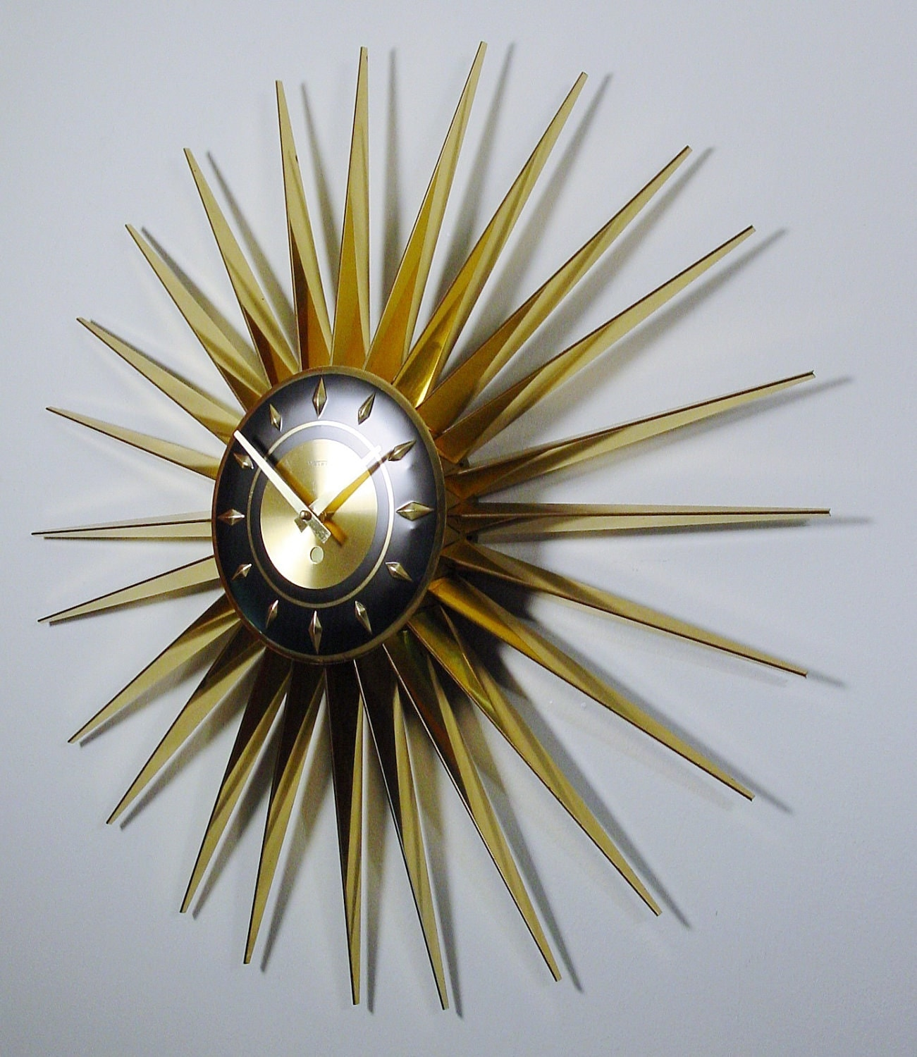 mid century modern starburst clock by welby 24 rays atomic. Black Bedroom Furniture Sets. Home Design Ideas