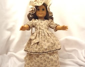 Beige, brown, and gold print, long dress for 18 inch dolls, with brown rick-rack trim.