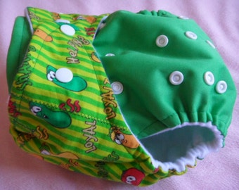 SassyCloth one size pocket diaper with veggie tales on green cotton print and green PUL. Made to order.