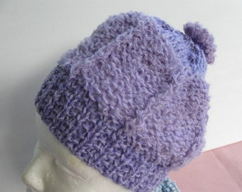 Hat  Original  Hand Knit  one of a kind.   Everyone of my hats is an original and worked  with different yarns and textures,  fun  to wear.