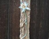 Pretty flower on bark background