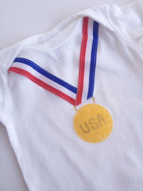 gold medal olympic one piece bodysuit