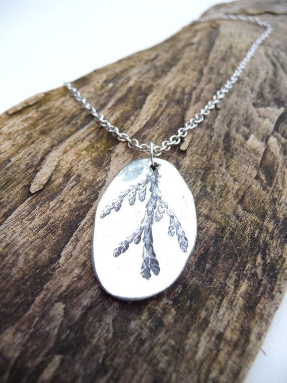 Cedar branch necklace created with recycled fine silver